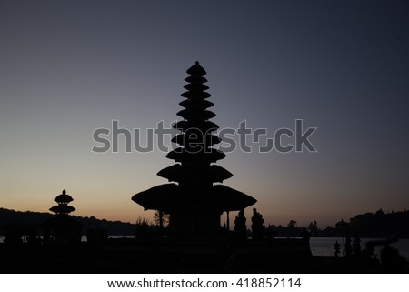 Pura Ulun Danu temple silhouette before sunrise on a lake Bratan. Bali, Indonesia - stock photo