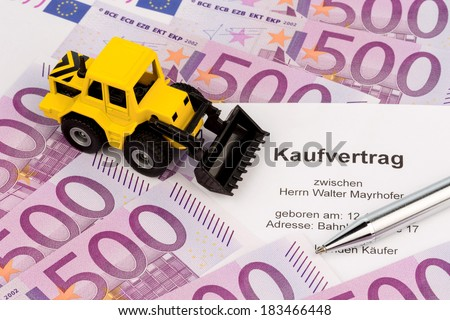 purchase contract for new excavator. located on euro banknotes - stock photo