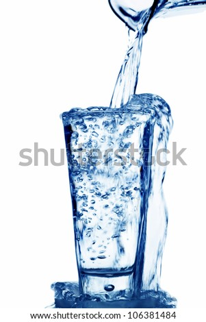 pure and clean water is poured into a glass. drinking water in the glass. - stock photo