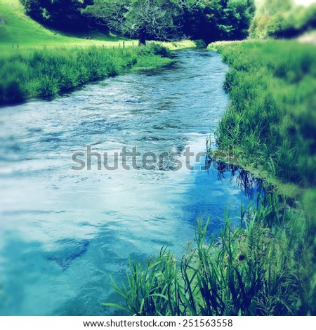 Pure clean spring water stream - stock photo