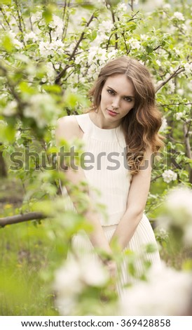 Pure femininity, outdoor shot of a brunette girl  - stock photo