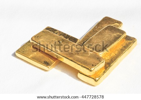 Pure ingots gold on the white background