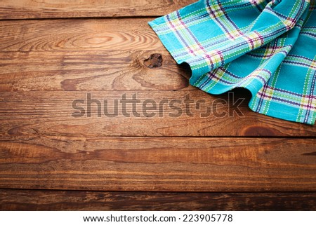 Pure notebook for recording menu, recipe on checkered tablecloth tartan. Wooden table close up view from top  - stock photo