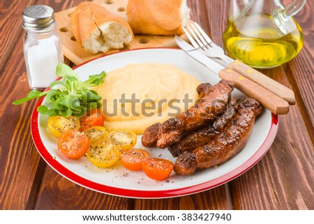 Pure plate with sausage and salad on rustic wood base