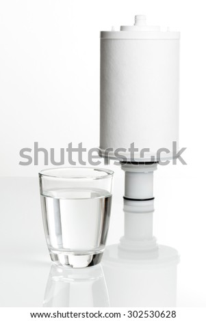 pure water in glass and water filter - stock photo