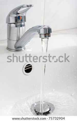 pure water running down from the faucet - stock photo