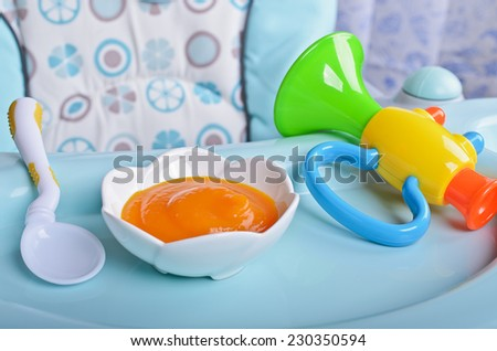 Puree bright orange as food for babies - stock photo