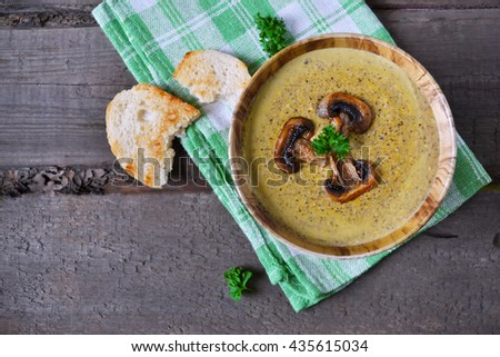 Puree soup with mushrooms and cheese, rustic style - stock photo