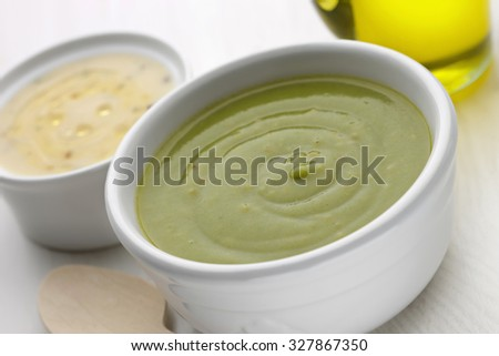 Pureed vegetables with olive oil on white wooden table - stock photo