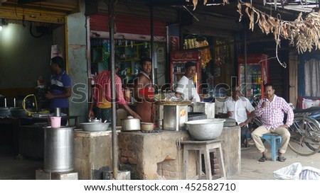 PURI, INDIA - 29 MAY, 2016: An unidentified Indian poor peoples sitting at street food shop.