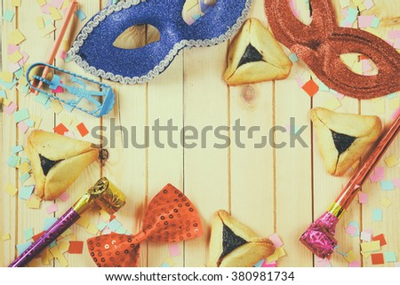 Purim celebration concept (jewish carnival holiday). selective focus. vintage filtered and toned - stock photo