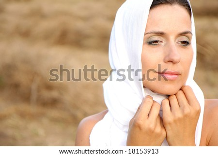 Purity woman on field with white scarf and clean face - stock photo