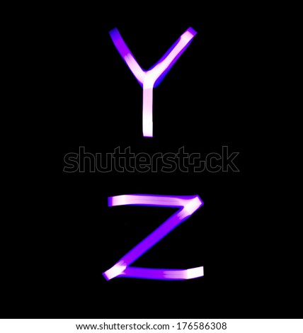 purple alphabet created with light (Y, Z) - stock photo
