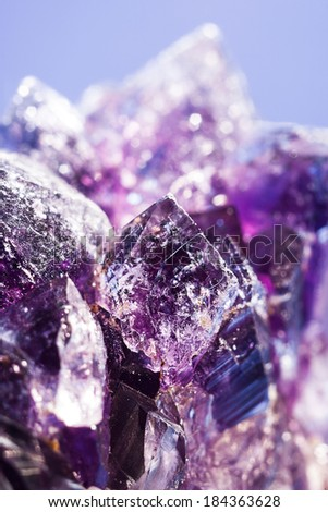 Purple amethyst stone over abstract background for your design - stock photo