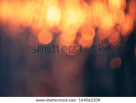 Purple and blue bokeh background.Orange lights. - stock photo
