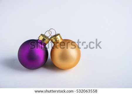purple and gold christmas balls on a white background