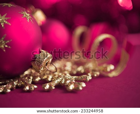 Purple and golden xmas ornaments on bright bokeh background. Merry christmas card. Winter holidays. Xmas theme. - stock photo