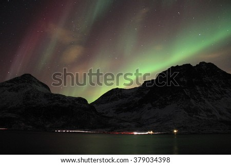 Purple and green northern lights in Tromso, Norway. - stock photo