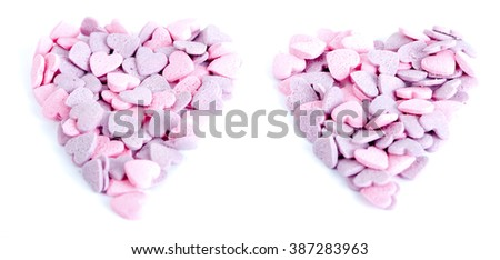Purple and pink candy hearts shaped in a heart