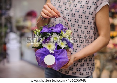 purple and pink flower bouquet composition  in hands