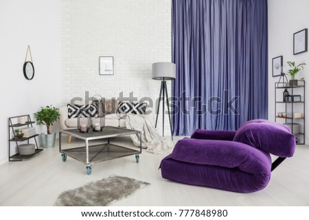Purple Armchair And Grey Rug In Modern Living Room Interior With Metal Table Front Of