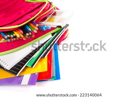 Purple backpack with school supplies, copyspace - stock photo