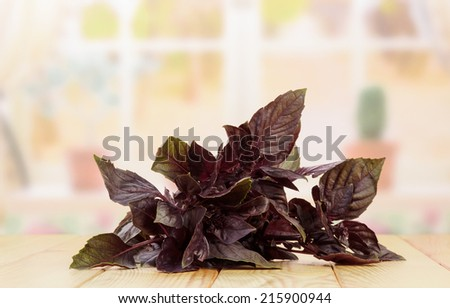 Purple basil leaves on table in chicken - stock photo