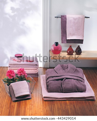 Purple bathrobe and pink towels
