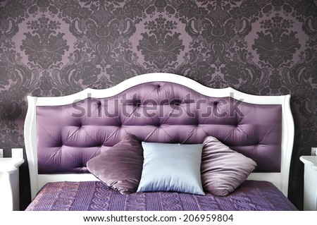 purple bedroom interior,  luxurious bed. - stock photo