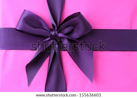 purple bow on pink gift box