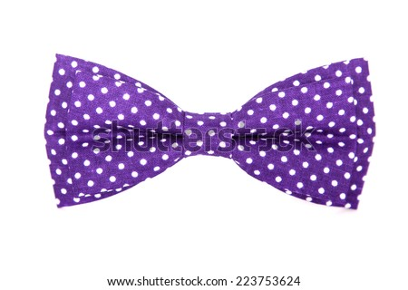purple bow tie with white polka dots on an isolated white background - stock photo