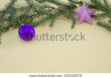 Purple Chirstmas ornament,pink star and a pine branch - stock photo