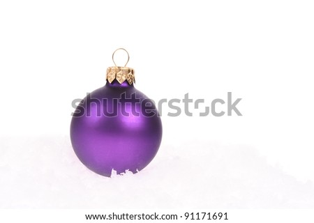purple christmas ball with snow on white background - stock photo