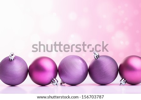 purple christmas balls over blurred background