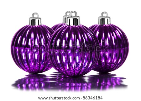 Purple christmas decoration baubles on white background - stock photo
