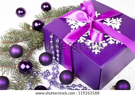 purple Christmas gift box with christmas balls