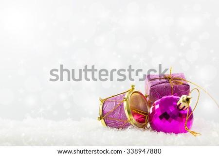 Purple Christmas ornaments against defocused lights background - stock photo