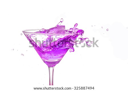 Purple cocktail splash on white background close up