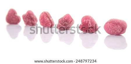 Purple colored sugar jelly candy over white background