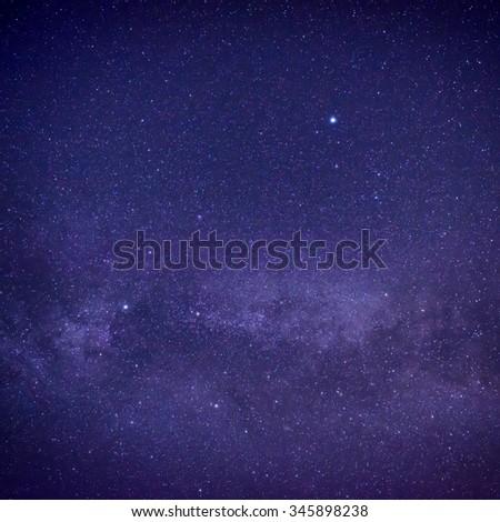Purple dark night sky with many stars. Space milky way background - stock photo