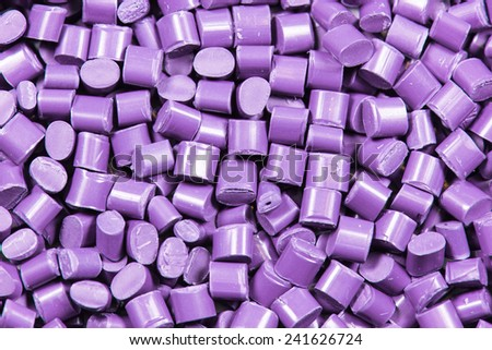 purple dyed polymer resin for background - stock photo
