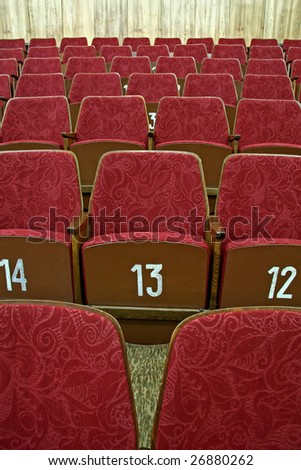purple empty cinema seats with white numbers, - stock photo