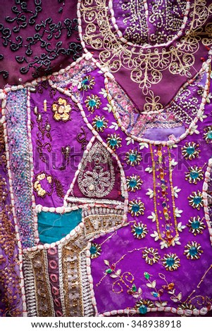 Purple ethnic Rajasthan cushion with mirrors on flea market in India - stock photo