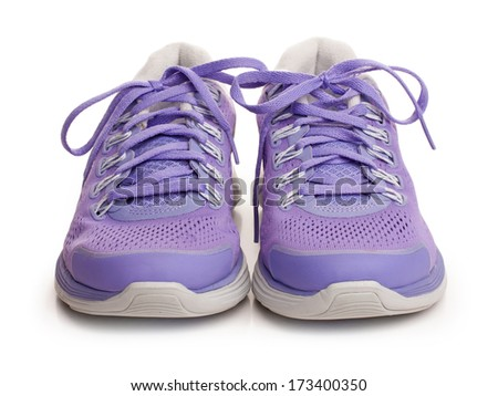 Purple female sport shoes isolated on white - stock photo