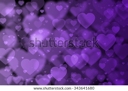 Purple hearts background with bokeh effect - stock photo