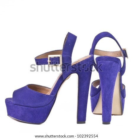 Purple high heel women shoes. Studio shot. Isolated on white background - stock photo