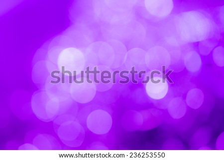 Purple holiday party background. Abstract with bright twinkles, sparkles, blurred, defocused light. - stock photo