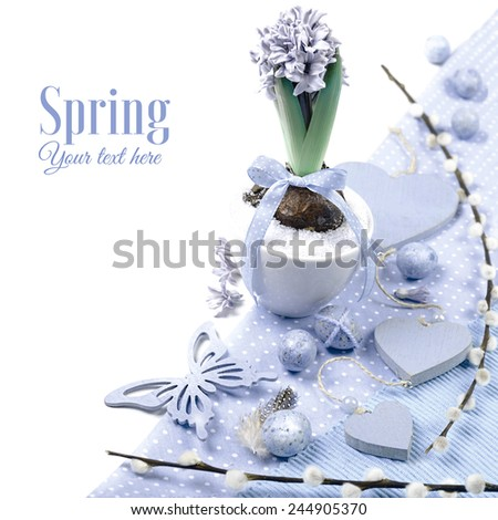 Purple hyacinth with matching Easter decorations on white background, toned image, corner element  - stock photo