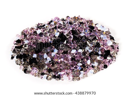 Purple jewel stones heap over white background