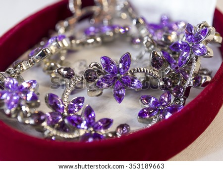 Purple jewelry in a form of flowers.